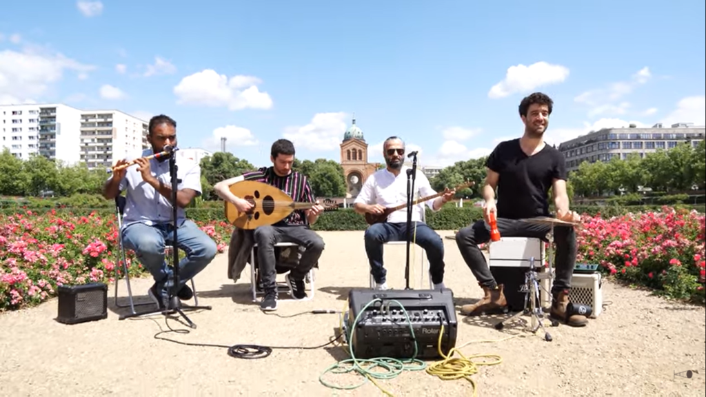 a band playing outdoors. cover photo